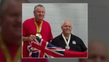 Scott Fraser with medals around his neck