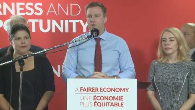 New Brunswick Liberal Leader Brian Gallant discusses pay equity during a campaign stop in Moncton on Sept. 12, 2018.