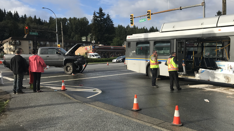 Crews respond to a crash between a pickup truck and a TransLink bus in Port Moody, B.C.