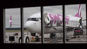 Swoop Airlines Boeing 737-800 on display during their media event, June 19, 2018 at John C. Munro International Airport in Hamilton, Ont. (THE CANADIAN PRESS/Tara Walton)