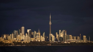 Light from the sunset hits the skyline in Toronto, Ont., on Tuesday October 31, 2017. THE CANADIAN PRESS/Mark Blinch