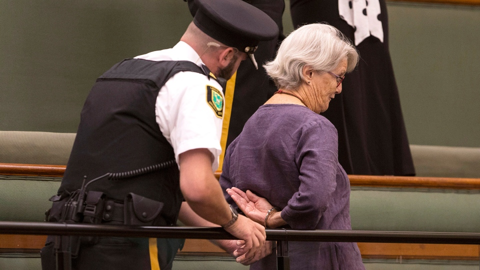 A protester in the public gallery is handcuffed by Queens Park Legislature Security during question period at the Ontario Legislature in Toronto on Wednesday, Sept. 12, 2018. THE CANADIAN PRESS/Chris Young