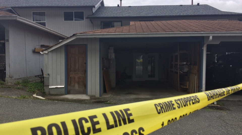 A home on Clark Drive in Port Alice sits behind police tape after an apparently targeted mail bomb explosion. Wed.,Sept. 12, 2018. (CTV Vancouver Island)