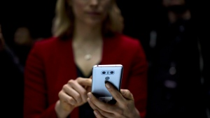 A woman holds the new G6 unveiled by LG as its next phone, ahead of Monday's opening of the Mobile World Congress wireless show in Barcelona, Spain, on February 26, 2017.THE CANADIAN PRESS/AP, Emilio Morenatti