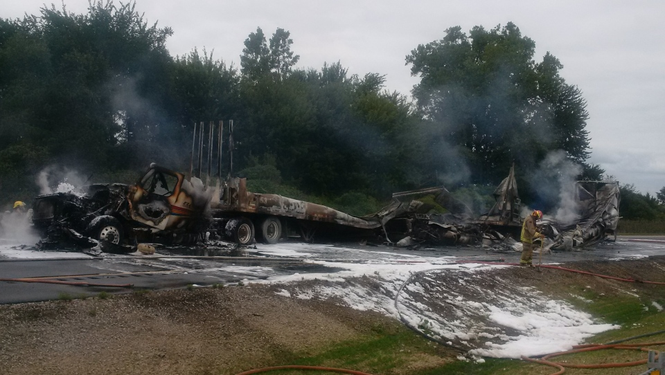Chatham-Kent OPP say a tractor trailer rear ended a vehicle in a fiery crash on Highway 401 near Kenesserie Road on Wednesday, Sept. 12, 2018. (Courtesy OPP)