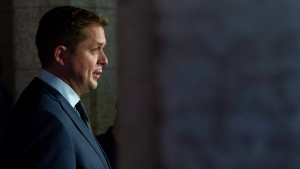 Leader of the Opposition Andrew Scheer speaks to the media in the foyer of the House of Commons in Ottawa, Wednesday September 12, 2018. THE CANADIAN PRESS/Adrian Wyld