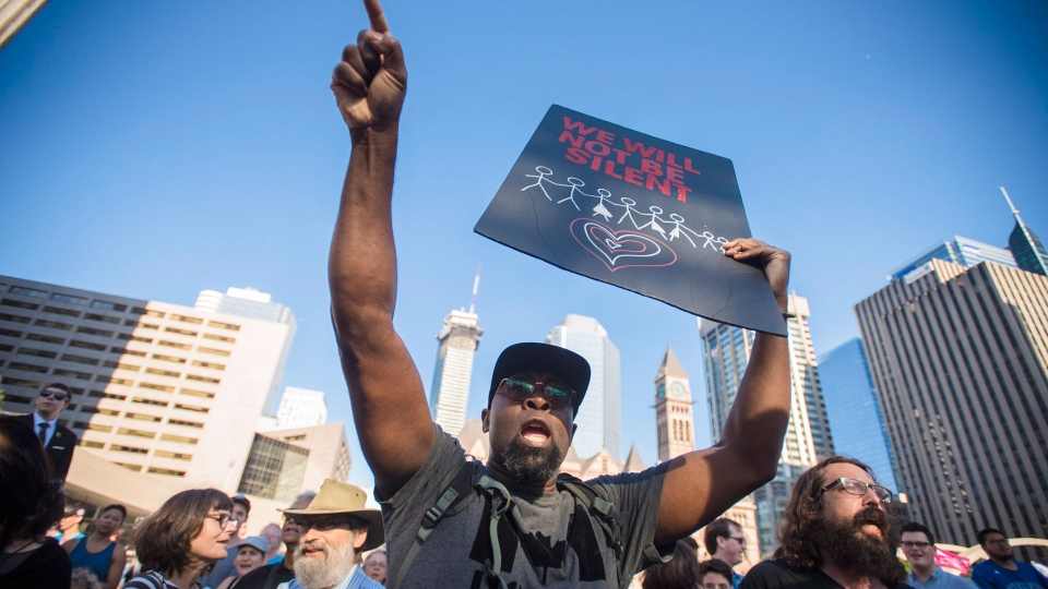 Don, last name withheld, leads a chant during Fight Back against Ford: Rally to Save our Democracy and Rights event at Toronto City Hall ion Wednesday, September 12, 2018. THE CANADIAN PRESS/ Tijana Martin