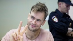 In this file photo taken on Monday, July 23, 2018, Pyotr Verzilov, a member of the feminist protest group Pussy Riot, gestures during hearings in a court in Moscow, Russia. (AP Photo/Pavel Golovkin, File)