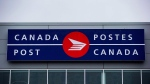 The Canada Post logo is seen on the outside the company's Pacific Processing Centre, in Richmond, B.C., on June 1, 2017. (Darryl Dyck/ The Canadian Press)