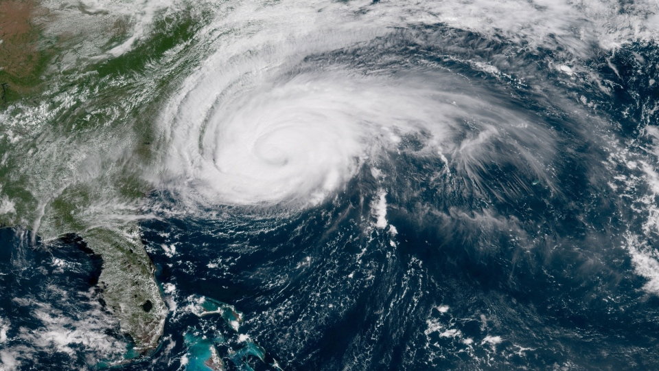 This enhanced satellite image made available by NOAA shows Hurricane Florence off the eastern coast of the United States on Thursday, Sept. 13, 2018 at 12:00 p.m. ET. (NOAA)