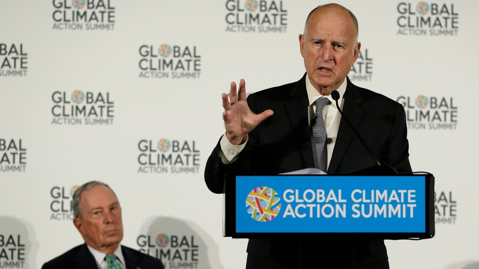 California Gov. Jerry Brown speaks as Michael Bloomberg, left, listens during a news conference at the Global Action Climate Summit Thursday, Sept. 13, 2018, in San Francisco. Gov. Brown started his global climate summit by saying that President Donald Trump will likely be remembered as a liar and fool when it comes to the environment. The Democratic Brown and former New York City Mayor Michael Bloomberg held a press conference Thursday on the first full day of the summit that is partly a rebuke of the Trump administration. (AP Photo/Eric Risberg)