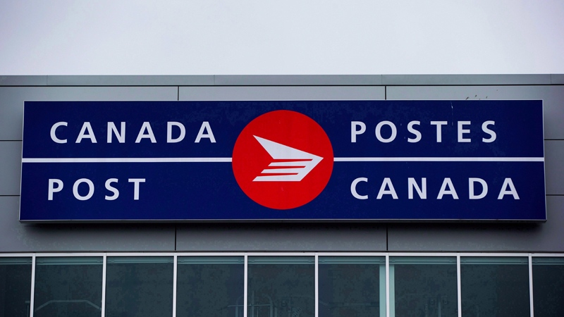 The Canada Post logo is seen on the outside the company's Pacific Processing Centre, in Richmond, B.C., on June 1, 2017. THE CANADIAN PRESS/Darryl Dyck