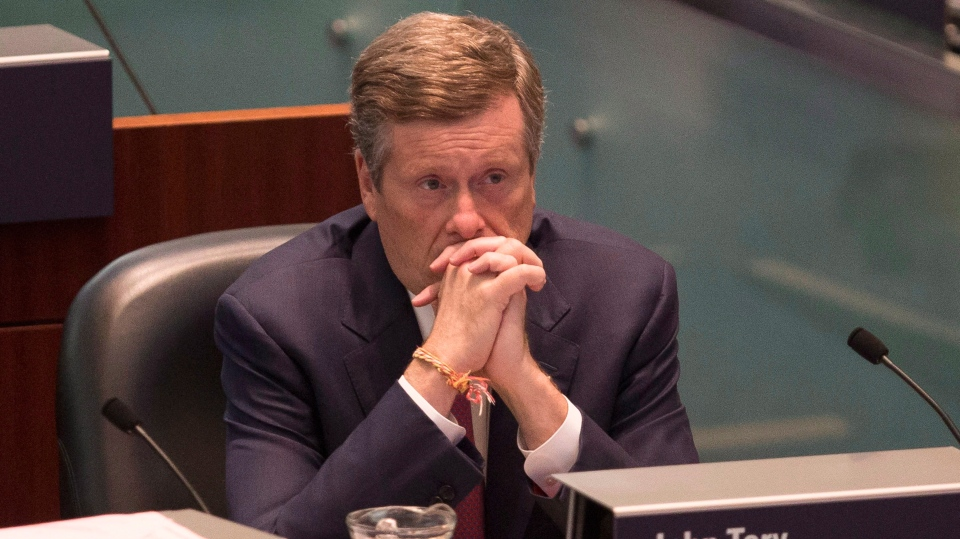 Toronto Mayor John Tory sits in the Council Chamber at Toronto City Hall, on Thursday September 13, 2018 as council sits to discuss the Ontario Government's introduction of legislation to reduce the size of Toronto City Council . THE CANADIAN PRESS/Chris Young