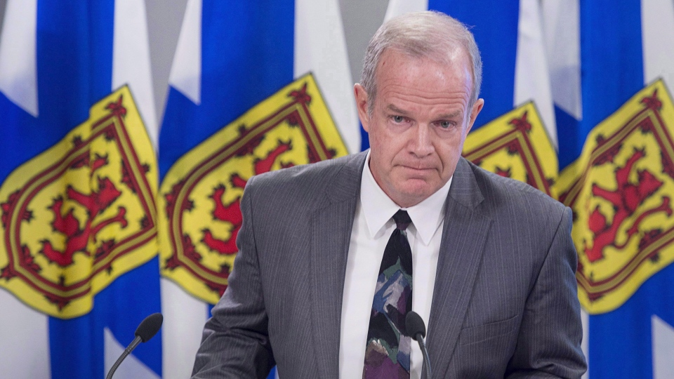Justice Minister Mark Furey listens to a question in Halifax on Tuesday, April 3, 2018. Nova Scotia's minister of justice says a 29-year-old man who was found unresponsive in his cell and died later in hospital was in the jail awaiting his court appearance. Justice Minister Mark Furey gave reporters a few added details today into the Sept. 10 death in the Central Nova Scotia Correctional Facility. (THE CANADIAN PRESS/Andrew Vaughan)