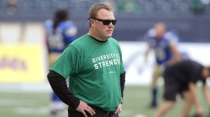 Saskatchewan Roughriders head coach Chris Jones warms up prior to CFL action against the Winnipeg Blue Bombers in Winnipeg on Saturday, September 8, 2018. (CFL PHOTO - Jason Halstead)