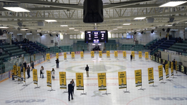 Sixteen banners in honour of the lives taken in the April bus crash are shown in the foreground and the banners for the survivors sit in the background during a tribute to the Humboldt Broncos in Humboldt , Sask., on Wednesday, Sept. 12, 2018. THE CANADIAN PRESS/Jonathan Hayward