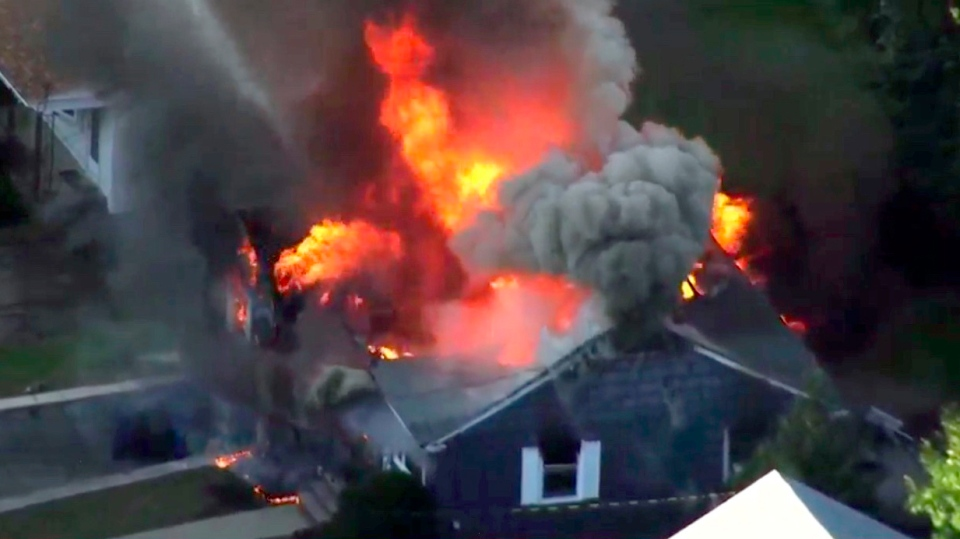 In this image take from video provided by WCVB in Boston, flames consume a home in Lawrence, Mass, a suburb of Boston, Thursday, Sept. 13, 2018. (WCVB via AP)