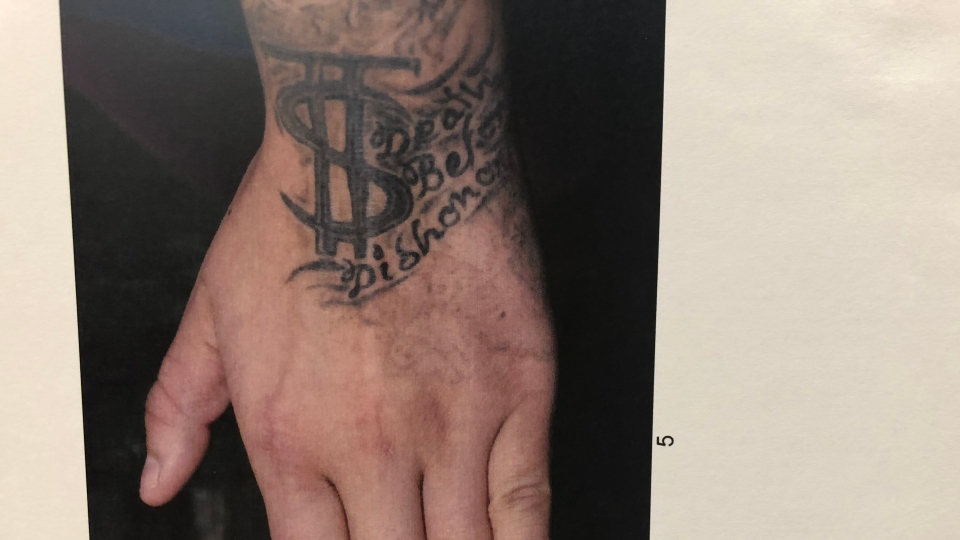 A court exhibit showing T S tattooed on Sutherland-Kayseas's wrist.
