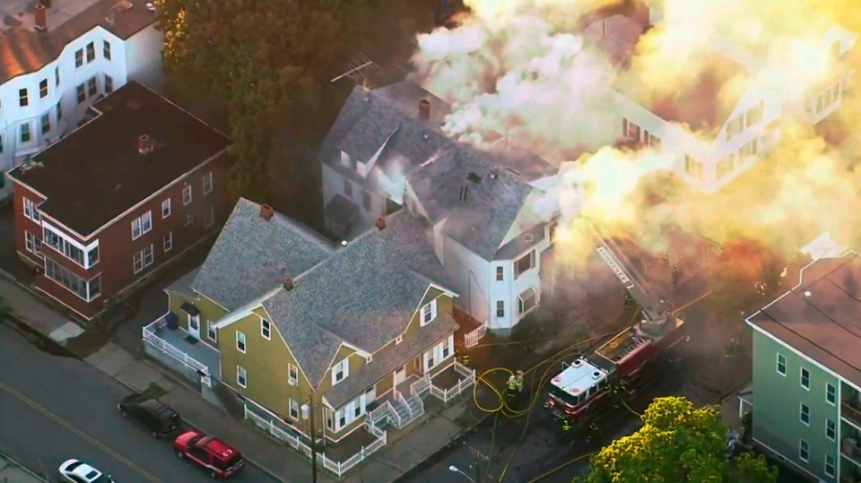 In this image take from video provided by WCVB in Boston, firefighters battle a large structure fire in Lawrence, Mass, a suburb of Boston, Thursday, Sept. 13, 2018.  (WCVB)
