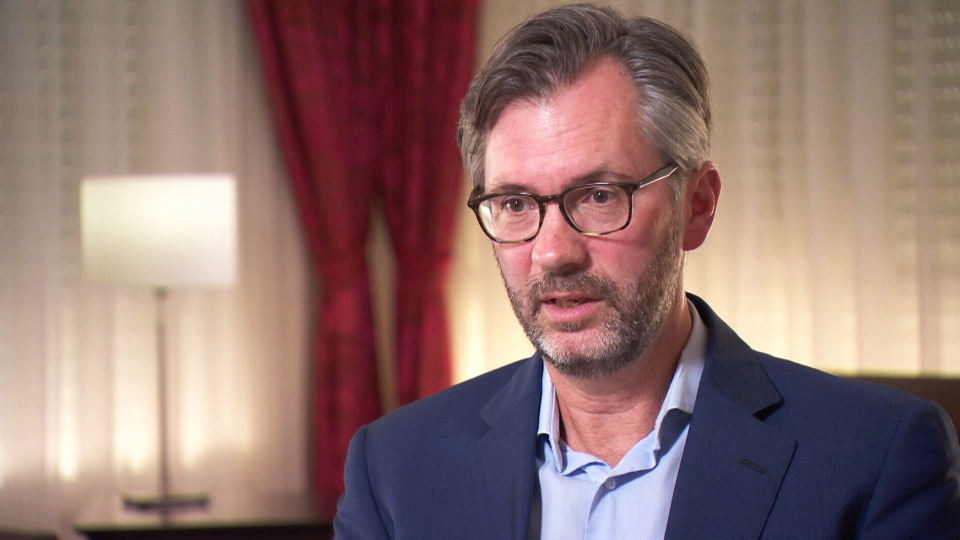 Peter MacDougall, Ambassador of Canada to Jordan, speaks to journalist Sally Armstrong.