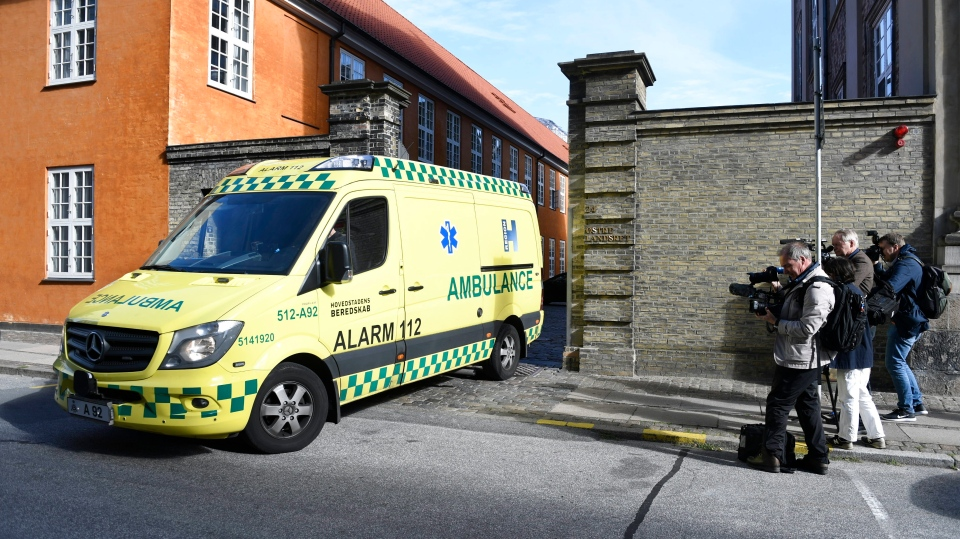 An ambulance leaves the Eastern High Court in Copenhagen, Denmark, Wednesday Sep. 14, 2018, on the last session of Danish submarine inventor Peter Madsen's appeal against his life sentence. The last session of Madsen's appeal against his life sentence for the murder of Swedish reporter Kim Wall was abandoned Friday after a juror collapsed during closing remarks. (Tariq Mikkel Khan/Ritzau Scanpix via AP)