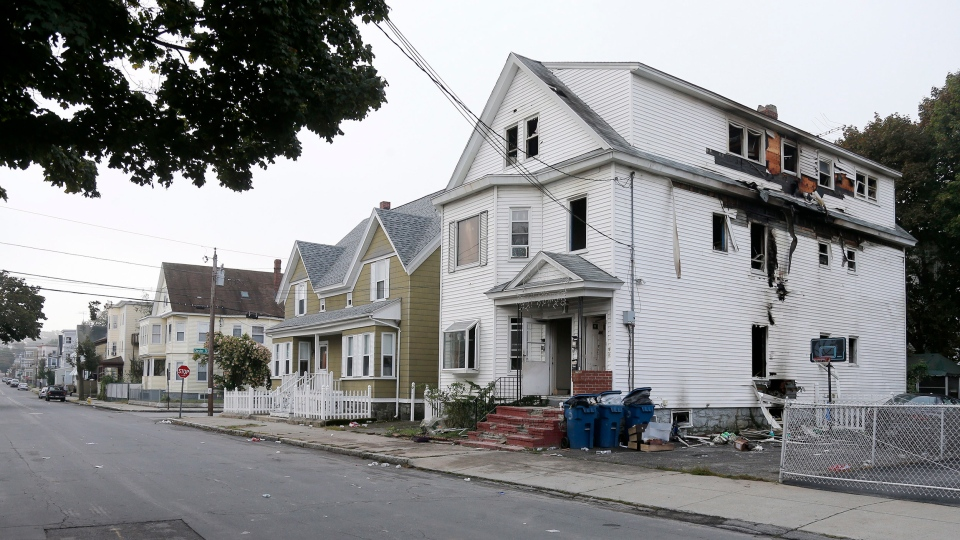A damaged house on Bowdoin Street in Lawrence Mass., is seen Friday, Sept. 14, 2018. (AP Photo/Mary Schwalm)