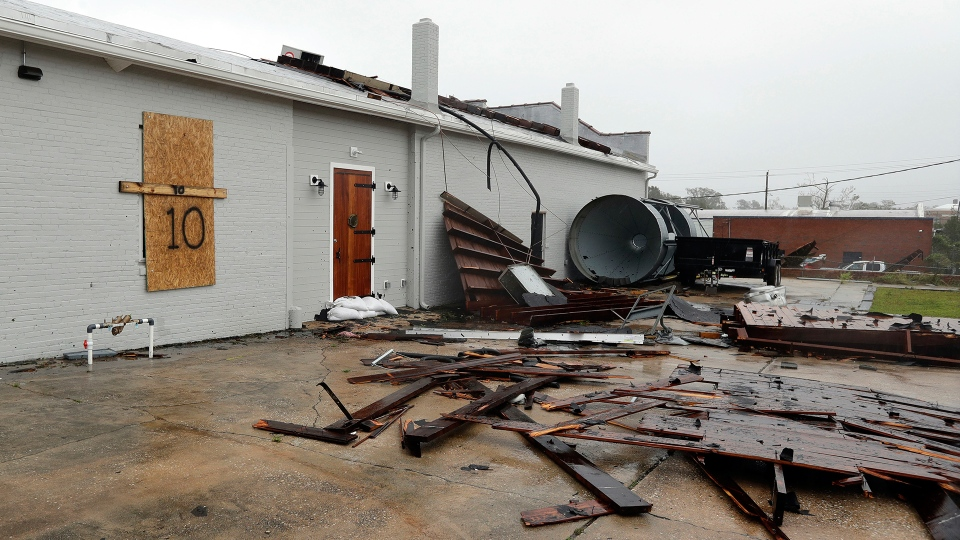 Part of the roof of Tidewater Brewing Co. lies on the ground in Wilmington, N.C., after Hurricane Florence made landfall Friday, Sept. 14, 2018. (AP / Chuck Burton)