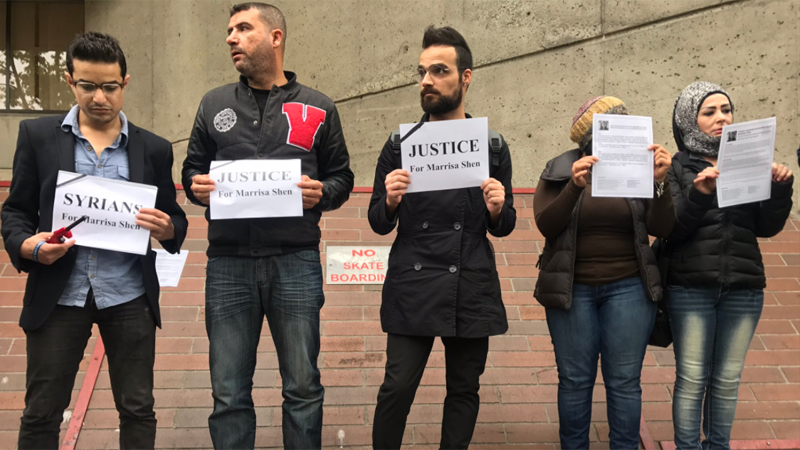 Advocates for the Syrian community hold a silent vigil outside court in support of murder victim Marrisa Shen's family. Sept. 14, 2018.