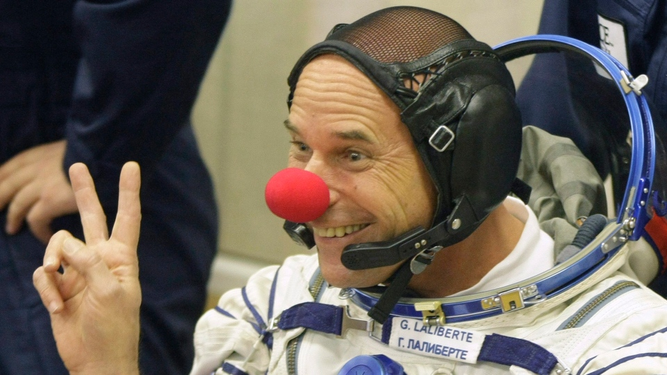 Canadian billionaire entertainer Guy Laliberte, a crew member of the 21st mission to the International Space Station, ISS, gestures while wearing a clown nose prior to the launch of the Soyuz-FG rocket at the Russian leased Baikonur Cosmodrome, in Kazakhstan, Sept. 30, 2009. (AP Photo/Mikhail Metzel)