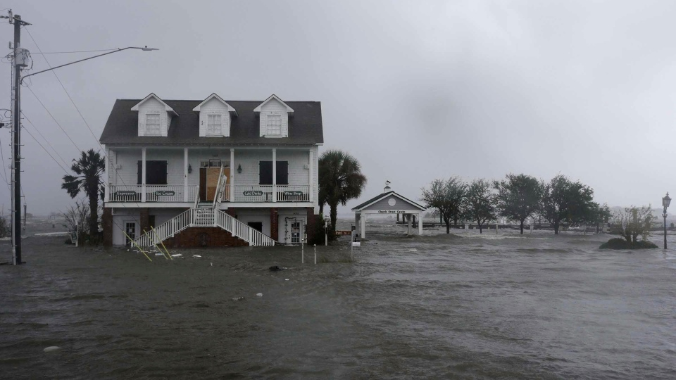 High winds and water surround a house as Hurricane Florence hits Swansboro N.C., Friday, Sept. 14, 2018. (AP Photo / Tom Copeland)