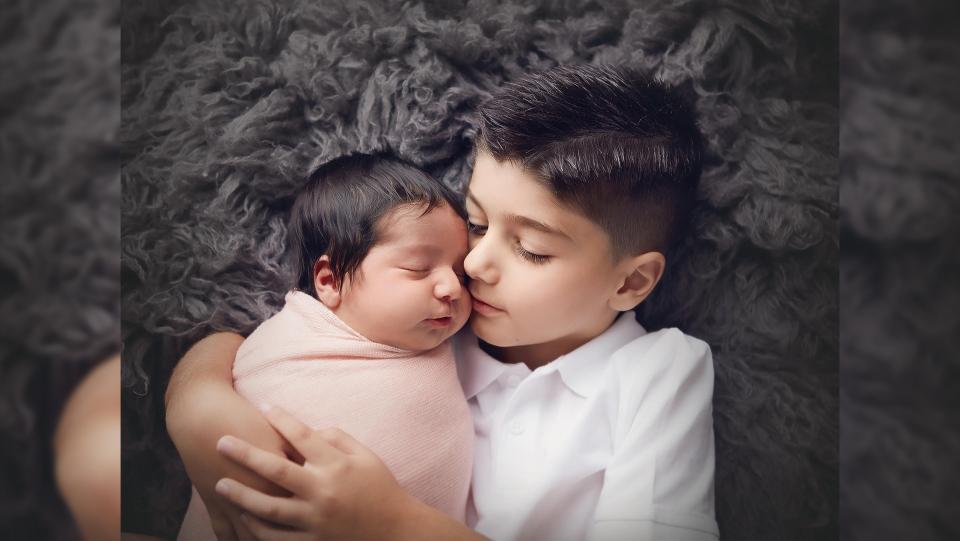 Nero, 5, holds his sister Adessa Grace Ismail. (Courtesy Michelle Meston / Portraits by Michelle)