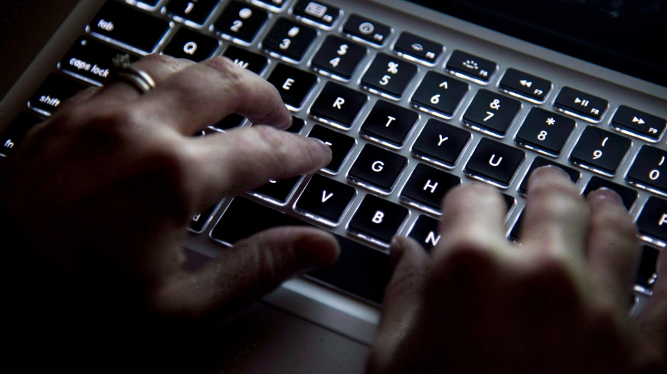 A woman types on a keyboard in Vancouver on Wednesday, December, 19, 2012. THE CANADIAN PRESS/Jonathan Hayward