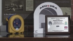 Defibrillator on a desk with a plaque