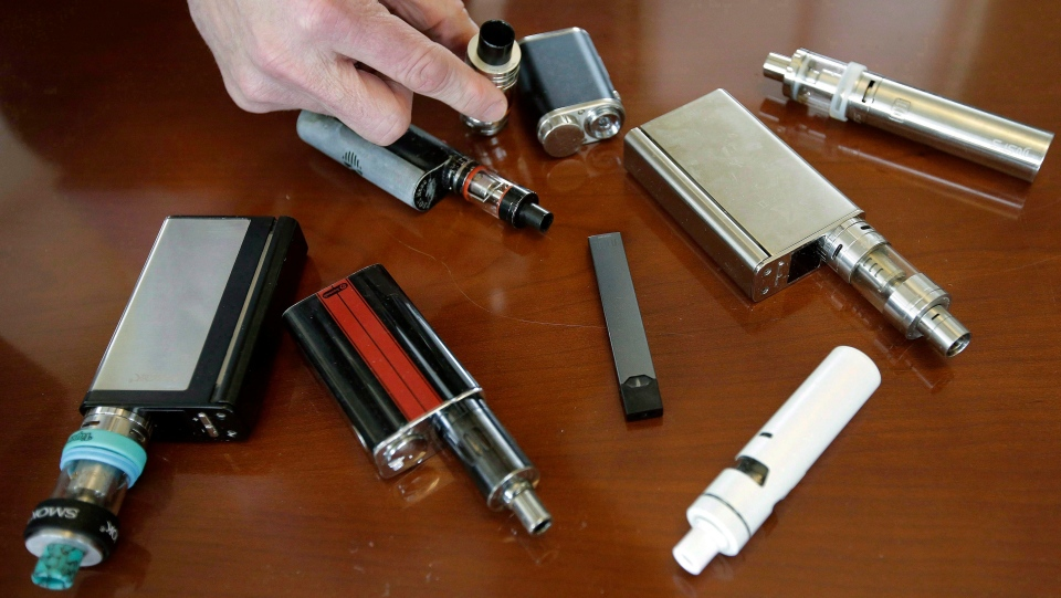 Vaping devices are shown in an April 10, 2018 file photo. A Wisconsin man has been arrested under suspicion of manufacturing counterfeit vaping cartridges. (THE CANADIAN PRESS/AP/Steven Senne)