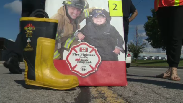 A fire fighter's boot next to a poster