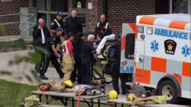 Emergency Services loading the Officer who was taken hostage into an ambulance. (File)