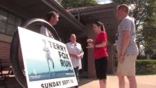 Heidi Davies next to a Terry Fox Run sign