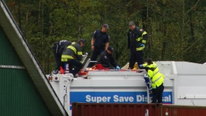 A woman suffered a broken hip and was rescued by firefighters after being found inside a garbage truck in Abbotsford, B.C.