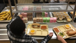 In this Jan. 25, 2017, file photo, students fill their lunch trays at J.F.K Elementary School in Kingston, N.Y., where all meals are now free under the federal Community Eligibility Provision. A donor inspired by a tweet raised money to pay off lunch debt in districts around the country, as well as thousands of dollars in overdue lunch fees at other schools in the Kingston district. (AP / Mary Esch, File)