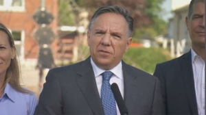 Francois Legault fielding questions from reporters