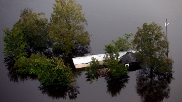 Floodwaters surround a trailer in the aftermath of Hurricane Florence in Pollocksville, N.C., Monday, Sept. 17, 2018. (AP Photo/Steve Helber)