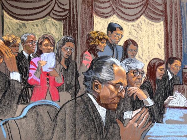 In this courtroom sketch, Bernard Madoff, center, is seated in front of some of his victims that spoke during his sentencing in Manhattan federal court in New York, Monday, June 29, 2009. (AP / Christine Cornell)
