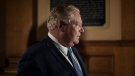 Ontario Premier Doug Ford arrives at his office the Ontario Legislature hold a midnight session to debate a bill that would cut the size of Toronto city council from 47 representatives to 25, in Toronto on Monday, September 17, 2018. THE CANADIAN PRESS/Chris Young