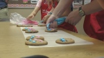 Chief Larkin helps decorate Smile Cookies