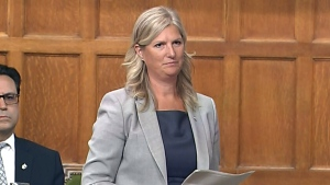 Liberal MP crosses floor to join Conservatives
