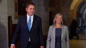 Leader of the Opposition Andrew Scheer walks with Leona Alleslev, who crossed the floor from the Liberal party to Conservative party before Question Period on Parliament Hill in Ottawa, Monday, September 17, 2018. THE CANADIAN PRESS/Adrian Wyld