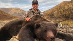 Former NHLer Tim Brent is taking some heat online after posted several image of a recent grizzly bear hunt. (Tim Brent/Twitter)