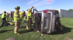 Emergency responders use the jaws of life on a vehicle in a mock accident
