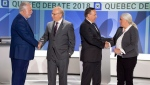 Liberal leader Philippe Couillard, left to right, PQ leader Jean-Francois Lisee, CAQ leader Francois Legault and Quebec Solidaire leader Manon Masse, right, shake hands before their English debate Monday, September 17, 2018 in Montreal, Que. (THE CANADIAN PRESS/Ryan Remiorz)