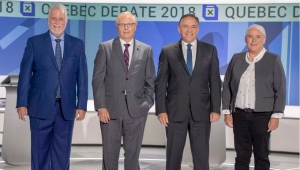 Liberal leader Philippe Couillard , left to right, PQ leader Jean-Francois Lisee, CAQ leader Francois Legault and Quebec Solidaire leader Manon Masse, right, pose for photos before their English debate Monday, September 17, 2018 in Montreal, Que. THE CANADIAN PRESS/Ryan Remiorz